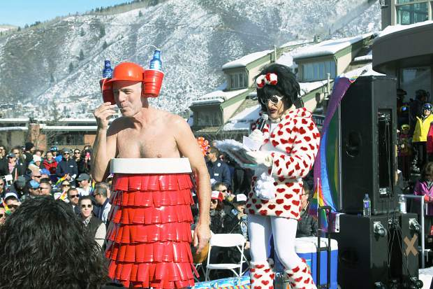 A contestant in the Downhill Costume Contest shows off his homemade costume as hostess Miss Richfield 1981 makes fun of him.