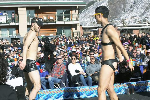 Kei Koizumi, right, and Jeff Dutton perform a risque dance on stage after skiing down Little Nell during Aspen Gay Ski Week's Downhill Costume Contest Friday.