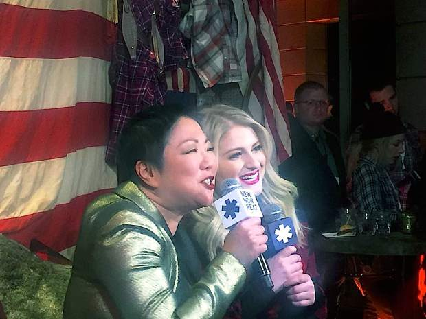 Margaret Cho, left, and pop star Meghan Trainor on-air Saturday night with Logo TV from the New Now Next Honors party as part of Aspen Gay Ski Week. Trainor went on to perform some of her hit songs, including