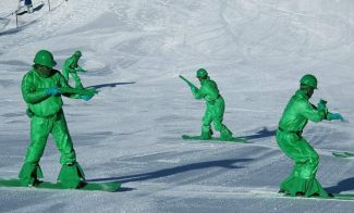 Members of the Colorado Green Force make their way down the Little Nell ski run as part of the Downhill Costume Competition, a fan favorite during Aspen Gay Ski Week.