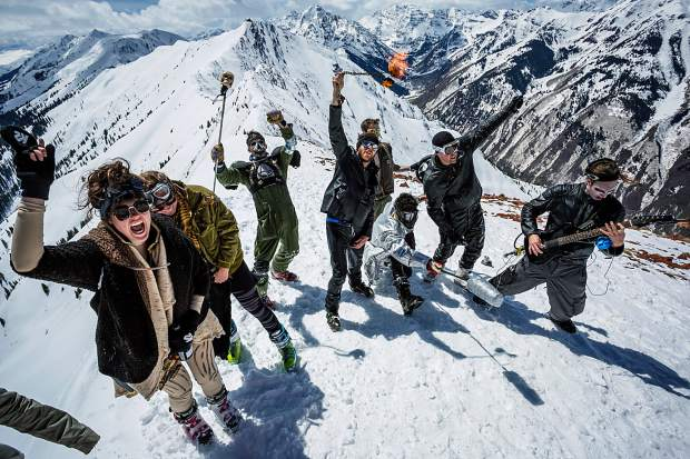 A group a partiers resembling characters from 'Mad Max' put on a show at the top of Highland Bowl on closing day Sunday.