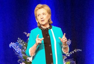 Former U.S. Secretary of State Hillary Rodham Clinton delivers a keynote address during a luncheon in Edmonton, Alberta on Wednesday June 18, 2014. (AP Photo/The Canadian Press, Jason Franson)