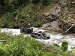 Two Jeeps ended up in the North Fork of the Crystal River July 2, as seen the following day. A Forest Service official said Monday the owner of one vehicle reported progress in getting them removed.