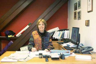 City Clerk Kathryn Koch sits in the City Hall office where she has worked for the past 40 years.