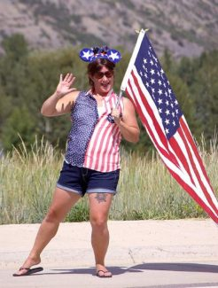 Resident Marisa Hutter shows some spirit on Aug. 19 as the USA Pro Challenge passes through Snowmass Village.