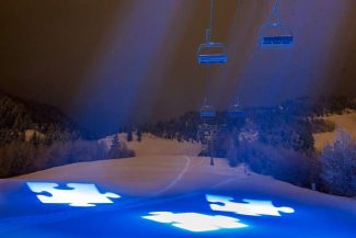 Aspen Mountain was cast in a blue glow with white puzzle pieces symbolizing the mystery and complexity of the autism spectrum during the Light it up Blue Gala in 2013.
