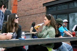 Vanessa Vieni, left, and Katie Kowalski have a drink Monday evening on the Square Grouper patio.