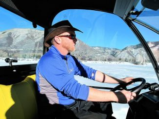 Aspen Parks and Open Space ranger Brian Long drives his John Deere Gator, which he uses to groom Nordic trails, on Friday.