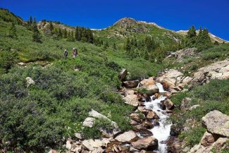 Backpackers descend from Linkins Lake off the Lost Man Loop. It is one of the alternatives close to Aspen for adventurers who want to avoid the crowds of the Maroon Bells Scenic Area.