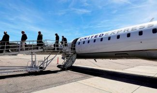 Travelers arrive Friday at Aspen-Pitkin County Airport, which is currently served by just one airline — United Express. Enplanements at the local airport were down overall for the winter season as the result of Frontier's departure, but both United and American Airlines gained passengers, compared to winter 2011-12.