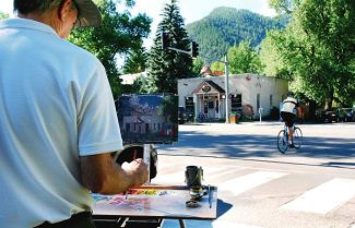 Douglas Morgan painting the Main Street Bakery & Cafe. Morgan is among 15 artists in town this week for Aspen Plein Air.