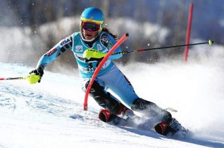United States' Mikaela Shiffrin passes the gate on her first run at the women's World Cup slalom ski competition in Aspen, Colo., on Sunday, Nov. 27, 2011. (AP Photo/Alessandro Trovati)