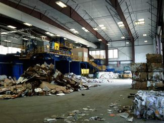 Eagle County sorts recyclable materials and prepares them for shipment at its materials recovery facility near Wolcott. The facility produced revenues of $6 million in 2013, though the recycling operation still needed a subsidy from the landfill operation.
