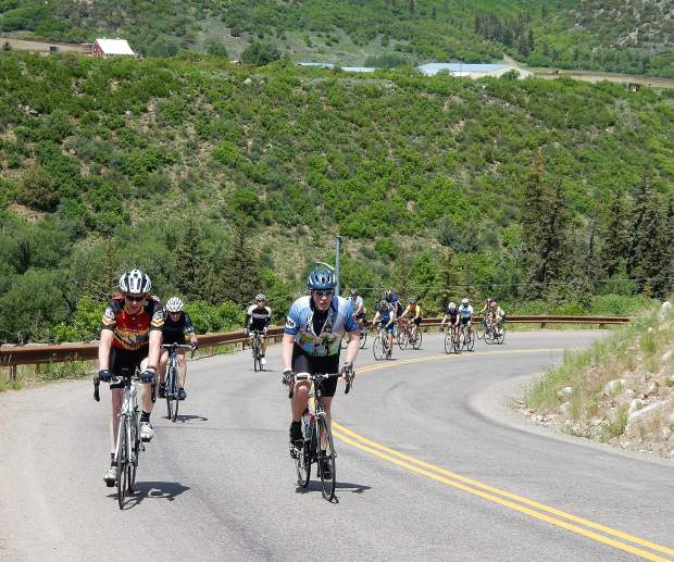 Riders huff and puff their way up Jaffee Hill on Sunday. The steepness of the climb caught many riders off guard.