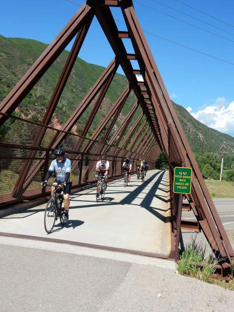 Riders cross the pedestrian bridge over Highway 82 at Wingo Junction on Saturday. More than 2,000 riders participate in Ride the Rockies.