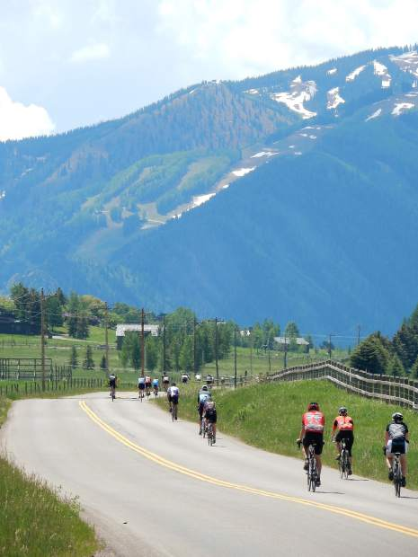 Riders head toward Aspen on McLain Flats road on the last leg of the Ride the Rockies 50-mile route from Carbondale to Aspen. August 21 marked the start of 2016 Ride the Rockies.