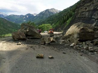 Large rocks tumbled onto Highway 133 about a mile below the McClure Pass summit on Sunday. The road is open but will require blasting of the big boulders to move them.