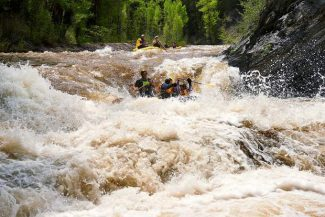 Scotty Gibsone of Kiwi Adventure Ko. guides a raft through Slaughter House Falls outside of Aspen Thursday. The Roaring Fork River flow topped 1,600 cubic feet per second there as conditions move closer to peak runoff.
