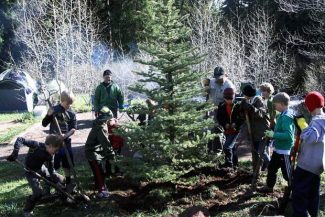 Cub Scouts from Pack 224 in Aspen plant a tree at the Silver Bar campsite at the Maroon Bells. The Cubs planted 27 trees as part of a community service project that also helped raise $4,100 for Pack 224.