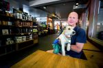 Ivan Lustig, with his service dog Kobi at Starbucks, has filed a federal complaint saying Cafe Ink violated his rights under the Americans with Disabilities Act.