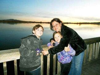 Lani Shaw, with her children Jack and Katie, at Bosque del Apache National Wildlife Refuge in November 2012.