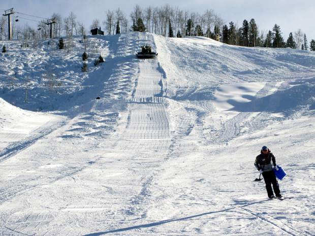 Course workers prepare the mogul course this week for the freestylers at the Stapleton Training Center at Aspen Highlands. A community party Tuesday will mark the center's official opening.