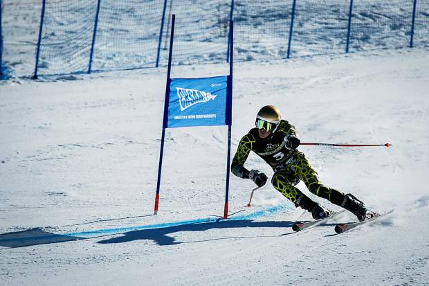 Battle Mountain's Quinton Cook past a gate en route to winning the boys giant-slalom title on Thursday at the state ski meet at Aspen Highlands. That's Cook's second state title as he won the slalom at least year's state meet.