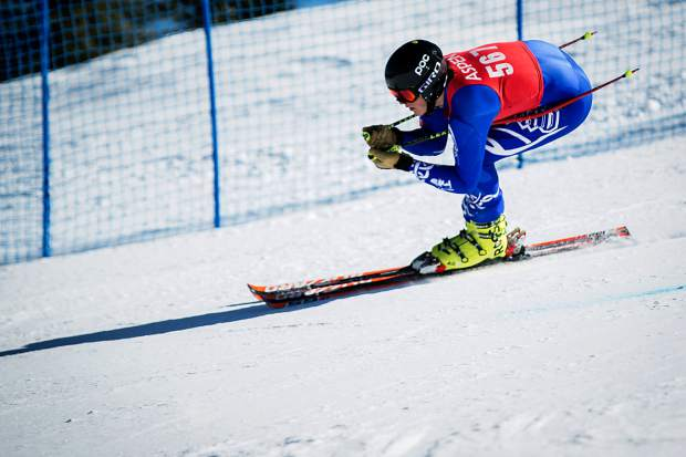 David Mondry of Aspen holds his tuck in the giant slalom Thurday at the state high school skiing championships at Aspen Highlands.