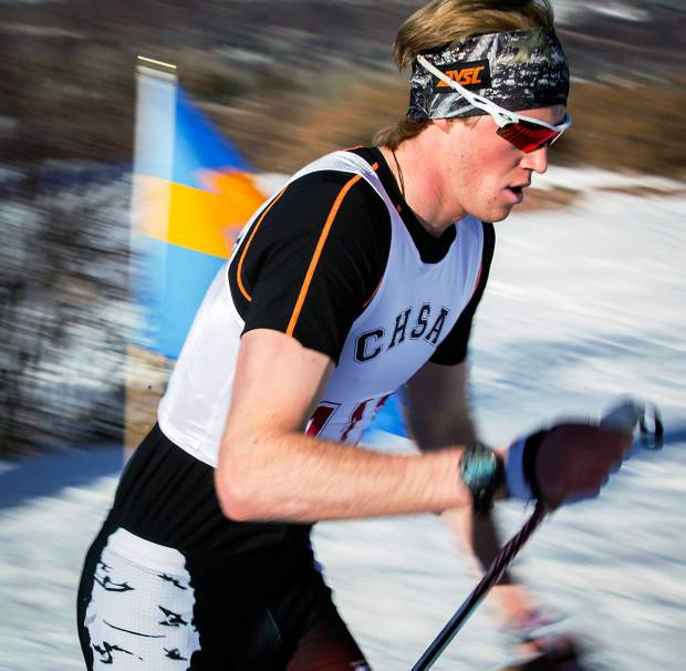 Aspen High School's Nick Sweeney charges to a state championship Thursday as he wins the boys 5K classic race at the state meet in Aspen.