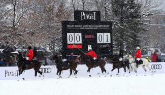 Snow polo players ride past the scoreboard in Wagner Park at the Piaget World Snow Polo Championship in 2013. With the park under construction, organizers will hold this year's event at Rio Grande Park instead.