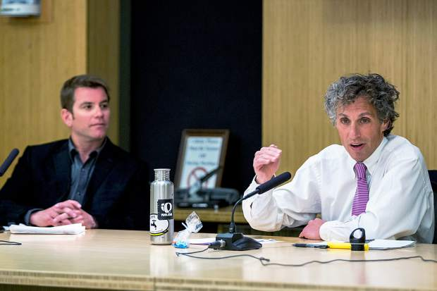 Mayor Steve Skadron, right, speaks as opponent Torre looks on Thursday during Squirm Night at Aspen City Hall.
