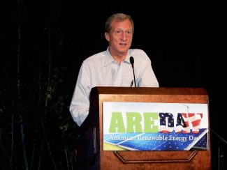 Tom Steyer accepts the Climate Hero Award at Amrican Renewable Energy Day in Aspen Wednesday.