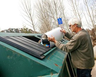 Joe Krabacher, of Woody Creek, deposits recyclable materials at the Rio Grande site in Aspen Tuesday. Pitkin County will hand over operations of the site to Waste Management on Monday.