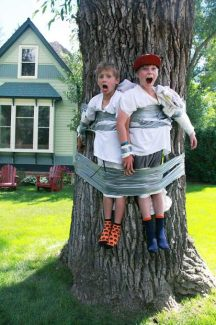 """Micah Sanders Silva (left) and Peter De Wetter, both of whom will be fourth-graders this fall at Aspen Elementary School, found themselves a bit too tied up to do in summer homework on a recent afternoon in the West End. """"We told passersby that they were getting a time out or that they were bear bait!"""" said Barbara Sanders, who submitted the photo. """"Then we water boarded them!"""""""