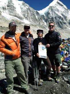 Boulder residents Aaron Breackel, Arnaud Dumont and Sylvie Pennaforte, along with Aspen's Ron Morehead, display a copy of The Aspen Times at an elevation of just above 18,000 feet, at the base camp of Mount Everest on April 7.