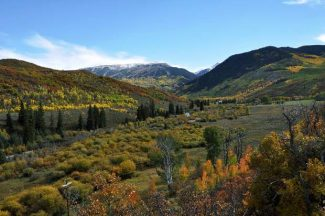 The majority of the land seen in this valley will become a conservation easement is the county commissioners approve the conveyance with the Clear W Ranch. The property on top of the ridge to the left would be annexed into Snowmass Village.