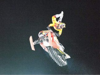 Colten Moore, of Krum, Texas, shows his gold-medal form in the snowmobile freestyle at the Winter X Games in 2014. He dedicated the victory to brother Caleb Moore, who suffered fatal injuries in a snowmobile crash at the X Games in 2013.