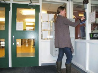 Eva Jankovsky, a Kids First employee, punches in a clearance code at the entrance to the Yellow Brick building Monday. Installation of the security system, which cost about $93,000, was completed this month.