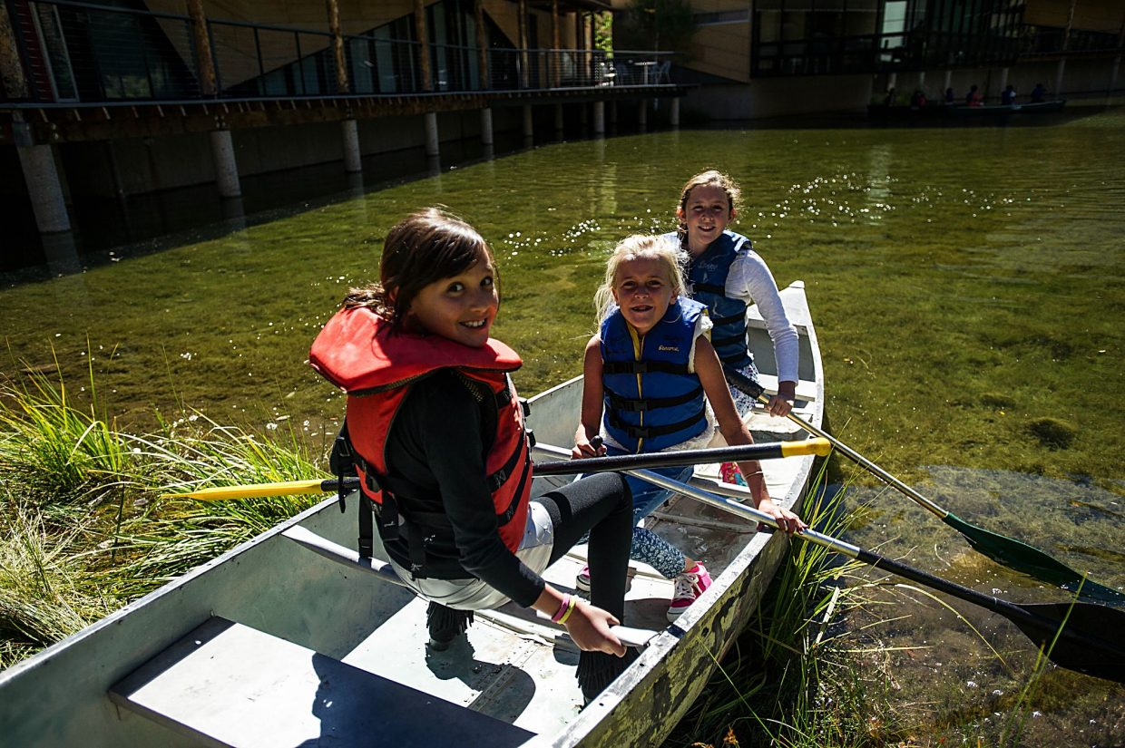 Aspen Country Day School students canoe on the pond during recess on Friday.