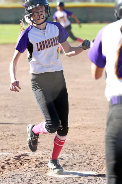 Basalt's Sequoia Kellogg touches home plate for the winning run against Gunnison on Saturday at the BHS softball field. Her run sends the Longhorns to the Class 3A state tournament.