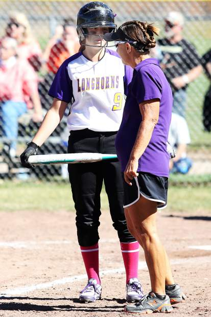 Basalt freshman Zoe Vozick chats with softball coach Marianne Gardner-Smith before an at-bat Saturday against Sterling.