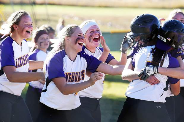 The Basalt High School softball team rushes to hug sophomore Sequoia Kellogg after she scored the winning run against Gunnison on Saturday at the BHS softball field. Her run sends the Longhorns to the Class 3A state tournament.