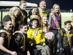 Basalt High School senior Oliver Harrington, center in yellow, is surrounded by members of the football team after being named homecoming king earlier this season.