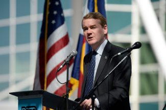 DENVER, CO - April 22: U.S. Senator Michael Bennet speaks on stage at the grand opening ceremony for the RTD University of Colorado A Line train at Denver International Airport April 22, 2016. The train service stretches from Union Station to Denver International Airport April 21, 2016 with five stations in between. (Photo by Andy Cross/The Denver Post via Getty Images)
