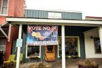 A banner opposed to the Basalt river park ballot question hangs on a Midland Avenue business. The logo is the same used on yard signs and flyers, yet opponents of the proposal claim they are acting as individuals.