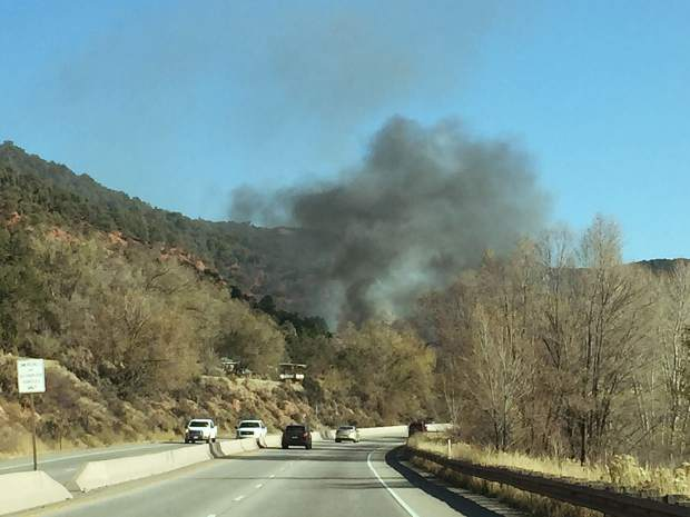 Smoke rises over Colorado 82 south of Glenwood Springs from a fire at Spring Valley Road.