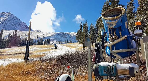 A snowgun sits on long, brown grass near the top of Black Mountain Express at Arapahoe Basin Ski Area on Nov. 2. Like many ski resorts in Colorado, A-Basin has been forced to cut back on early-season snowmaking due to above-average temperatures in October.