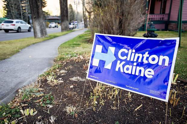 A sign supporting Hillary Clinton for president lines a yard in Aspen.
