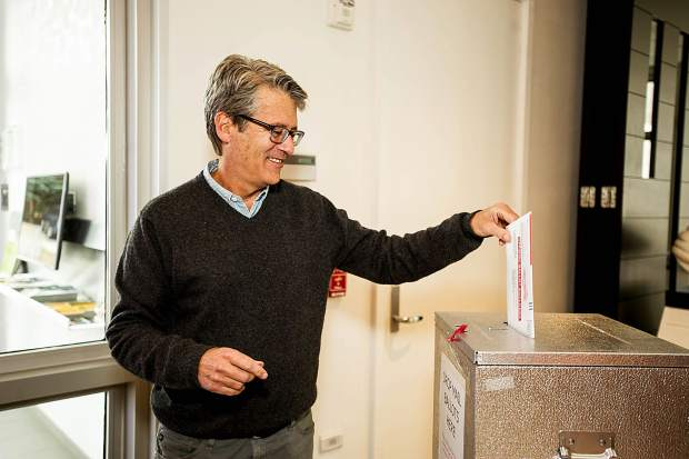 County Commissioner candidate Scott Writer casts his vote on Friday afternoon at the Aspen Jewish Community Center.