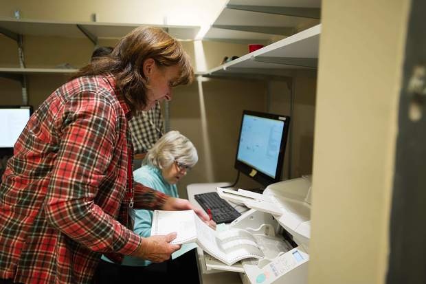 Carol Jenkins aids in the election ballot process at the Pitkin County Clerk and Recorder's Office on Friday.